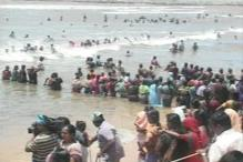 Pics: Kudankulam protestors form human chains in sea