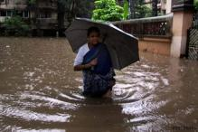 Mumbai comes to a halt, Met predicts more rain