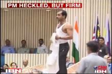 Watch: Man strips, raises slogans as PM address meet