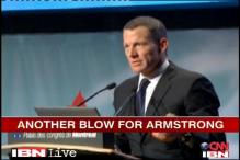 Armstrong dropped by Nike, steps down as Chairman
