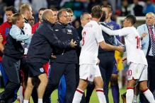 UEFA charges Serbia, England as police probe brawl