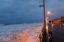 Sandy strengthens as nears coast; Wall Street shut