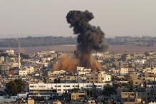 Israel launches scores of airstrikes into Gaza