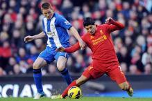 Suarez seals comfortable Liverpool win