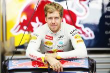 Wild ride keeps Vettel's F1 title hopes on track