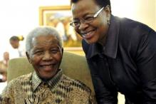 Nelson Mandela's health is improving, but to stay in hospital