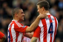 Walters scores twice as Liverpool lose 3-1 at Stoke
