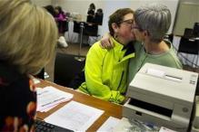 Same-sex couples take wedding vows in Washington