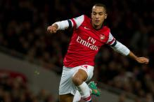 Theo Walcott stars as Arsenal rout Newcastle 7-3
