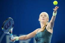 Defending champ Azarenka battles her way to fourth round