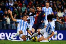 Barca wary of Malaga but Real almost in Copa semis