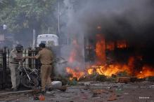 Dhule riots: Video shows policemen looting shops