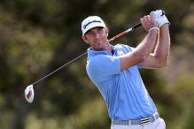 Johnson wins windswept PGA season-opener at Kapalua