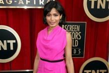 Snapshot: Freida Pinto breaks monotone with bright pink gown