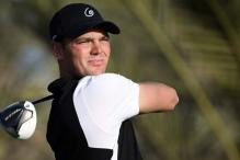 Kaymer outshines Tiger, McIlroy in Abu Dhabi Rd 1