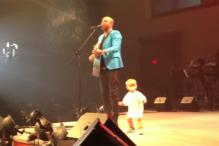 Watch: Adorable 17-month-old crashes daddy's concert