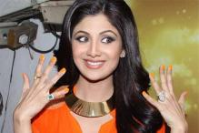 Fashion Watch: Shilpa Shetty's bright orange dress, chunky neck piece