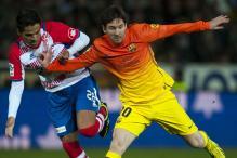 Messi completes 300 goals as Barcelona beat Granada 2-1