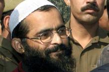 Afzal Guru hanged, buried in Tihar jail; two injured in protests in Kashmir