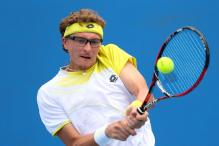 Denis Istomin beats third-seed John Isner at US Indoor