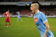 Napoli beat Catania 2-0, move level with Juve