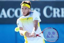Juan Monaco loses opener in Brazil