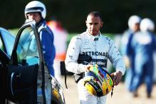 Hamilton crashes in first test with Mercedes