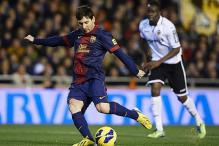 Messi gives Barcelona 1-1 draw at Valencia