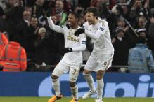 Swansea thrash Bradford 5-0 to win first major trophy