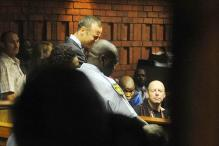 Weeping Pistorius faces premeditated murder charge