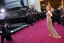 Armani racks up early fashion wins at Oscars