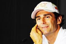 Pedro de la Rosa's Ferrari spouts smoke during testing