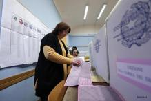 Protest votes add to uncertainty in close Italy election