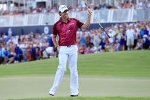 Poulter backs Europe Ryder captain McGinley to come good in 2014
