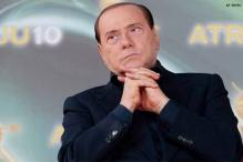 Italy's Berlusconi hints open to alliance with center-left