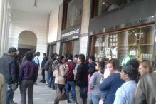 Long queues, but smiles welcome Starbucks to the heart of Delhi