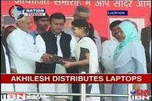 UP: Akhilesh distributes laptops to students in Lucknow