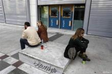 Cyprus scrambles to avert meltdown, EU threatens cutoff