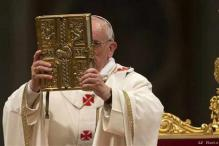 Pope presides over trimmed Easter Vigil service