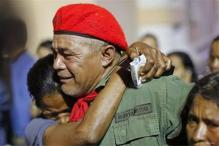Mourning Venezuelans parade Chavez's coffin, prepare for vote