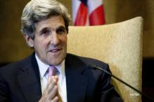 Kerry in Afghanistan to prod Karzai on future ties