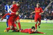 Suarez leads Liverpool to 4-0 win over Wigan