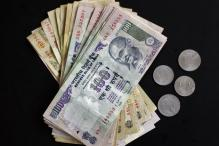 Rupee drops 18 paise against dollar in late morning trade