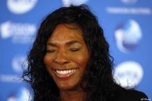 Serena gets in trouble for trying to photograph Tiger Woods
