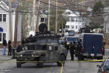 Shots fired in Massachusetts as police seek bomb suspect