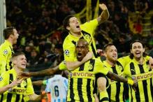 Borussia Dortmund beat Malaga 3-2 to enter Champions League semis