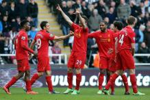Liverpool rout Newcastle 6-0 as Suarez ban begins