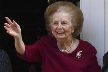 Cameron says Thatcher made Britain great, others snub her