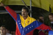 Chavez's heir Maduro to take over divided Venezuela