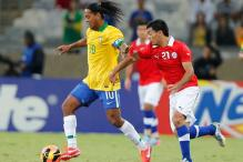 Brazil booed by own fans in 2-2 draw with Chile